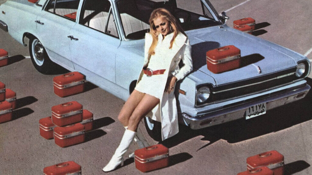 Iranian women leaning on a Paykan car, surrounded by boxes —edited by Ask An Iranian