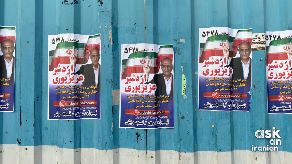 Promotional posters for a Tehran city council candidate for the 2021 elections, situated on Valiasr Street.