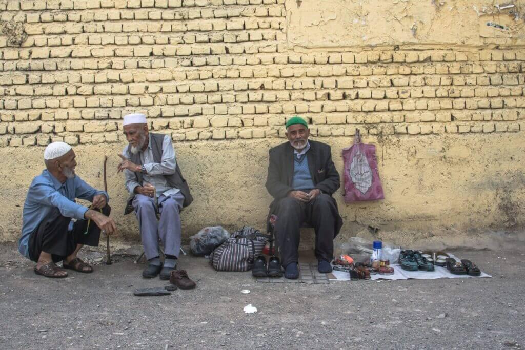Aghanistani men in Qom, Iran. Photo by Javad Esmaeili via Unsplash.
