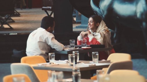 Ask An Iranian - Couple sitting drinking coffee in a café in Tehran, Iran